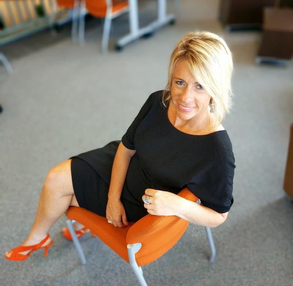 Kari In Chair Before Speaking